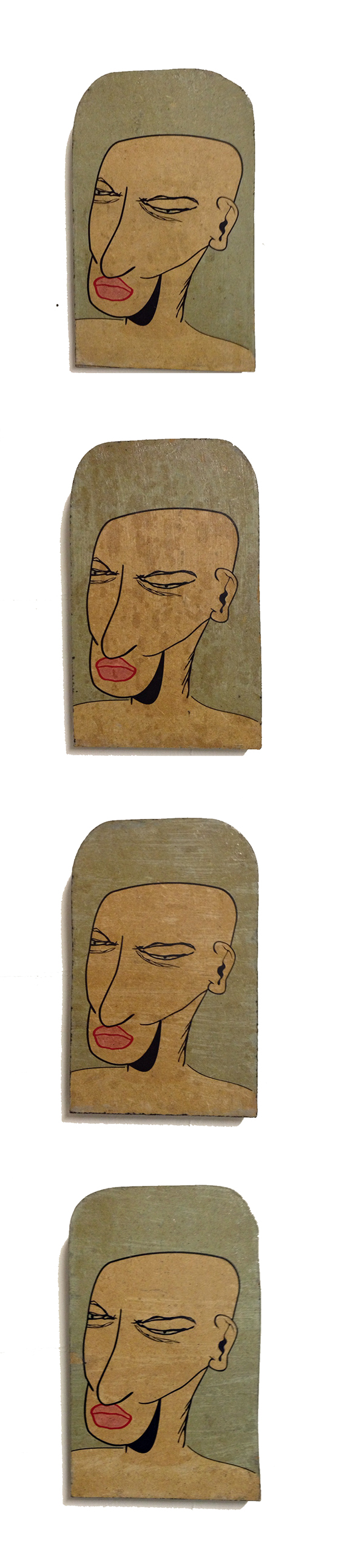Four Faces on Wood